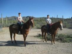 Katie and Luke horseback riding in Arizona