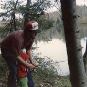 Luke learning to fish from his dad