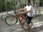 Luke riding a bike through Mexican ruins
