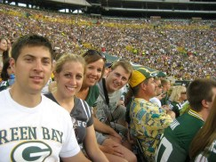 Luke, Katie and her family at a Packer's home game