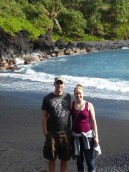 Luke and Katie visiting a black sand beach in Hawaii