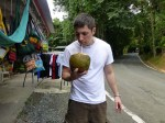 Luke trying a coconut in Puerto Rico
