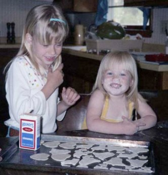 Katie and her sister baking cookies when she was a kid