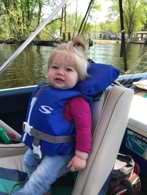 Ellie riding on the boat
