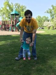 Luke teaching Ellie to walk