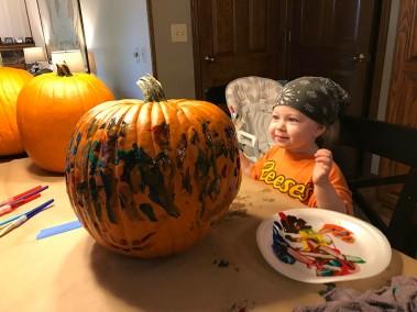 Ellie painting Halloween pumpkins