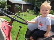 Charlie on a tractor. (His favorite place to be!)